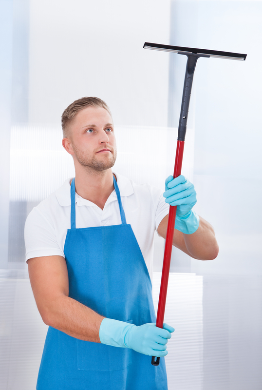 man holding squeegee