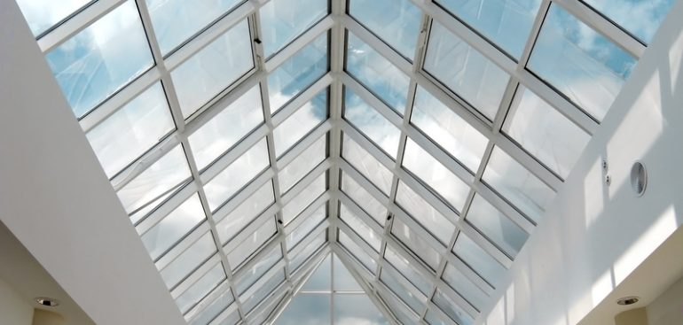 clean conservatory roof with blue sky in background