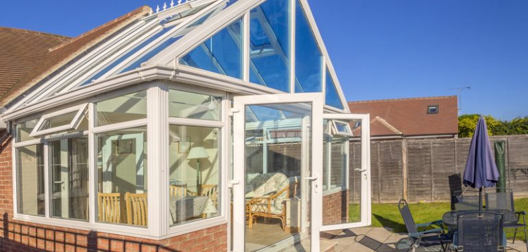Conservatory with doors open outside