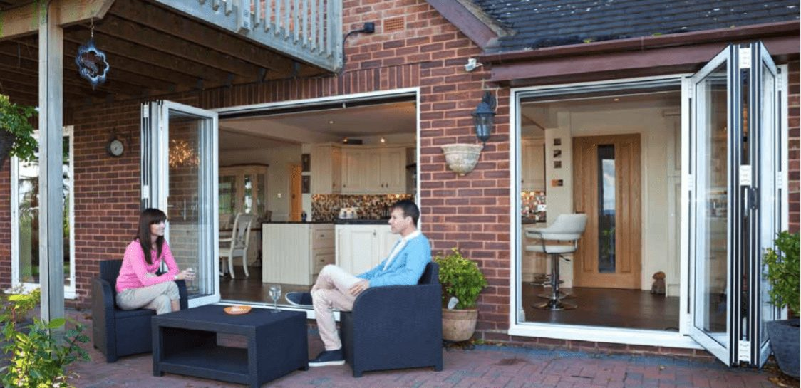 Bi-Fold Doors Open with People Sitting on Patio