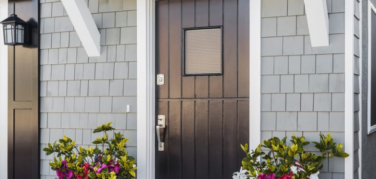 Black front door with flowers