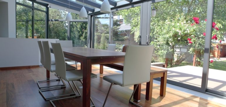 Dining room table and chairs in modern conservatory