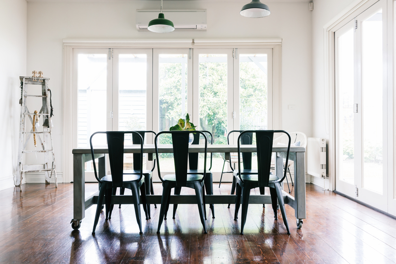 vintage style dining table and chairs with bifold doors