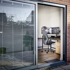 Sliding patio door halfway open with a grey frame.