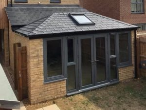 Dark grey French patio doors leading out to a garden.