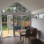 White pvc bifold doors with three windows, installed a home.