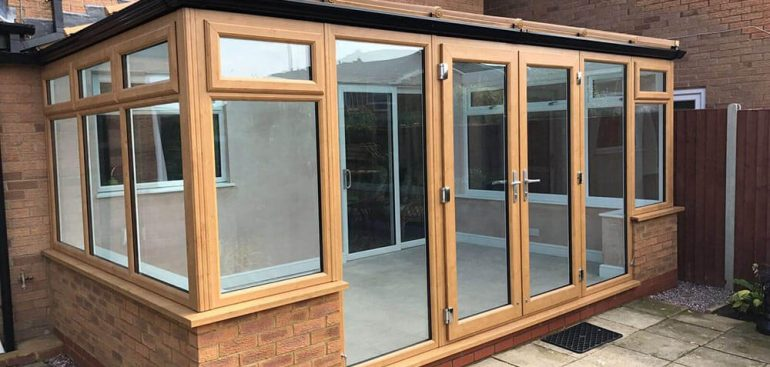 An image of newly installed French doors with a brown door frame.